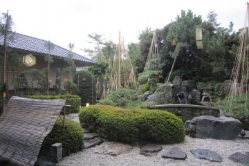 Japanese garden. Yukitsuri is already in place to protect trees from heavy snow