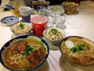 Our family of four dined for 2,240 yen; we ordered two small Okinawa Soba bowls for our young boys, a large pork rib soba for my wife, a large soft soki soba for myself and enjoyed the complimentary wheat tea and water