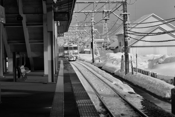 A JR Joetsu line train arrives at Urasa Station with snow all around. Get into the cozy train and it will wind through some of the most beautiful landscapes and give you great views of Niigata's snow country.