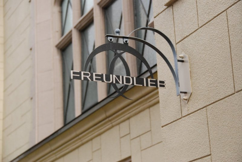 <p>The sign outside Freundlieb&nbsp;Cafe</p>