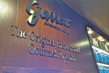 <p>Garrett Popcorn Shops sign inside the store</p>