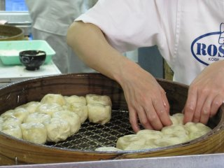 The chefs at work, preparing delcious nikuman (steamed bun with meat filling)