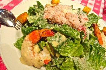 <p>Jumbo Shrimp &amp; Snow Crabmeat over Classic Caesar Salad</p>