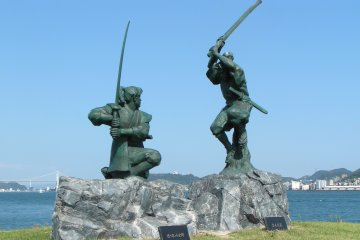 The statues of Miyamoto Musashi and Sasaki Kojiro in their famous duel