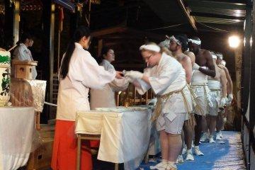 <p>Receiving sake at the main shrine.&nbsp;</p>