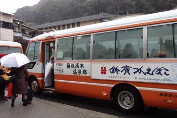 After you reach Hakone-Yumoto station, go to the information center. In front of it there are three bus stops, A, B, and C for the hotels and inns in this area. The bus for Ichino-yu Honkan leaves from bus stop C