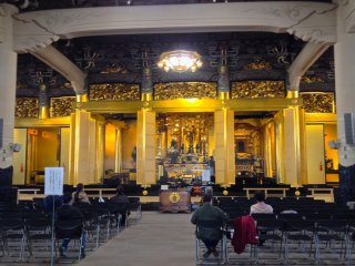 The temple on the inside is a wide hall with seating for visitors to sit and meditate. The aroma of the essence sticks burning permeates the temple's interior and it creates a religious ambience to pray.