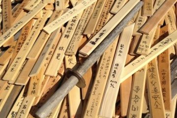 Wooden swords cover the warriors grave.