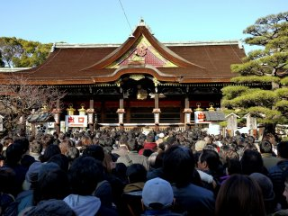 Crowds of hatsumode (first visit of the New Year) visitors make offerings and pray for the coming year.